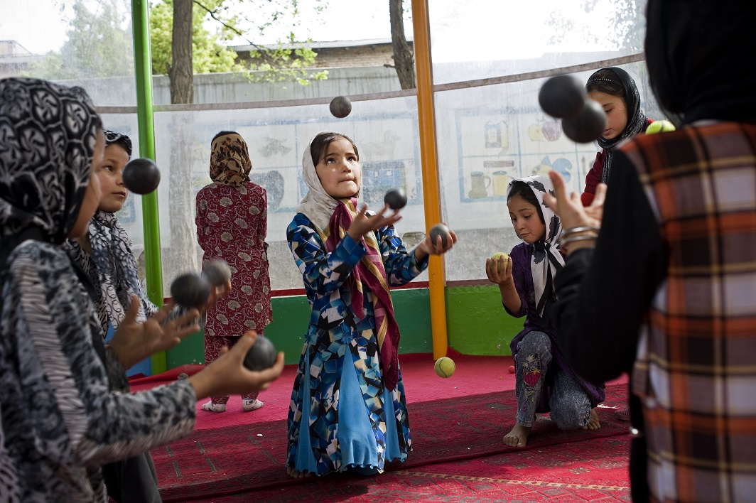 A young Afgan girl juggles balls during practice in the Afghan Mobile Circus School. Kabul, Afghanistan, 2012 (c) Wendy Marijnissen